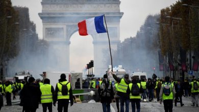 Photo of French police fire tear gas at protesters on Champs Elysees