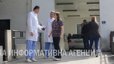 Photo of Doctor speaks to members of the media outside the Emergency Center