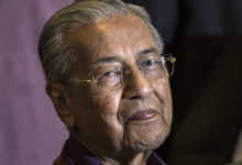 Photo of Malaysian Prime Minister Mahathir Mohamad quits government