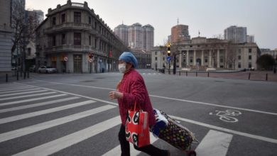 Photo of China reports zero new virus deaths; Wuhan to lift last restrictions