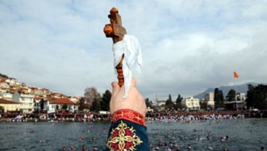 Photo of Orthodox Christians celebrate Epiphany at muted church services