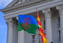 Photo of Romani people flag raised in front of Government building